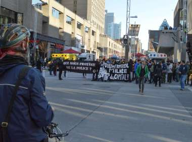 Demonstrators rallying in solidarity with victims of police brutality