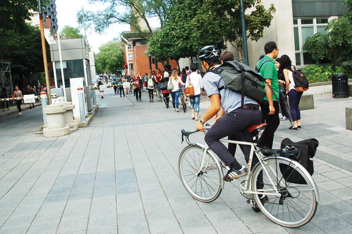 student bikes on campus