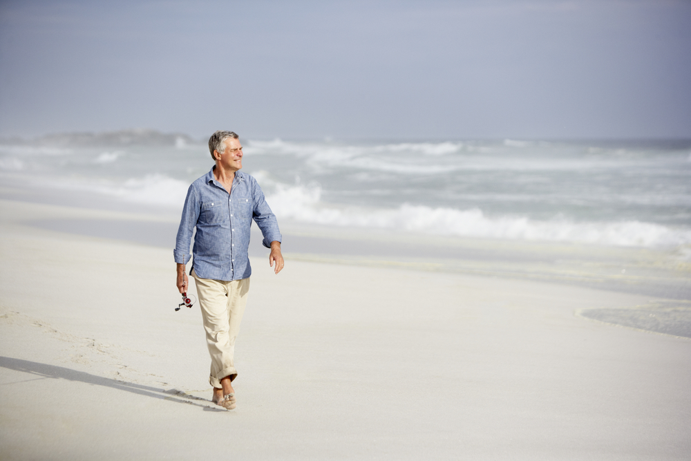 Happy older man on beach