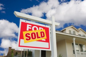 Sold Home For Sale Sign in Front of New House