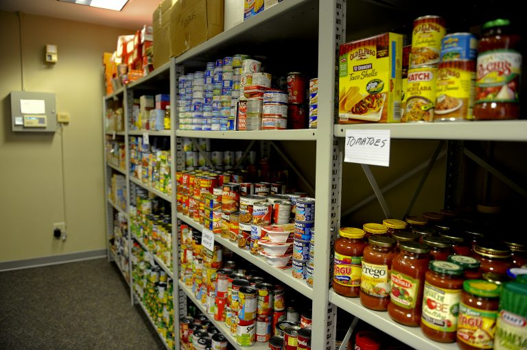 A picture of canned goods on shelves.