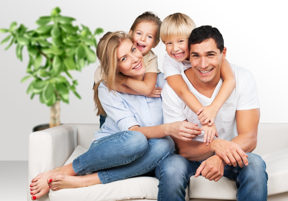 Picture of a happy family that rests easy knowing their fireplace was serviced and repaired as needed. Have your fireplace service done in the Spring to ensure you know ahead of time about any repairs you may need. This will give you time to tackle them at your own convenience. Service also removes creosote from the flue, reducing the chance of a chimney fire.