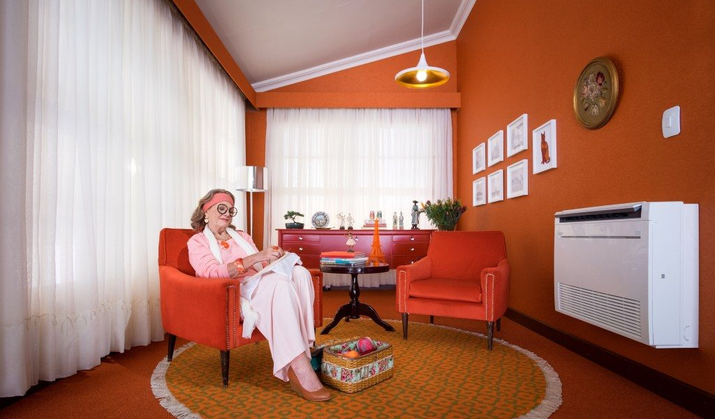 A photo of a grandmother enjoying her own specific heat/cooling temperature independent from the rest of the home.  Ideal zoning improves energy savings.