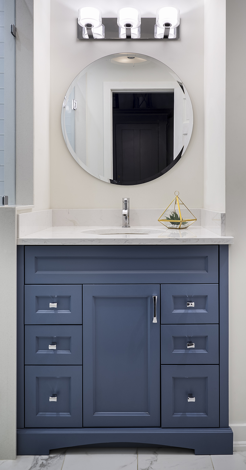 Classic Blue-Grey Bathroom with custom Vanity in blue-grey solid paint finish,  Cambria quartz counter top, classic Lighting, contemporary Shower Stall, Toilet niche, white, grey and blue-grey.