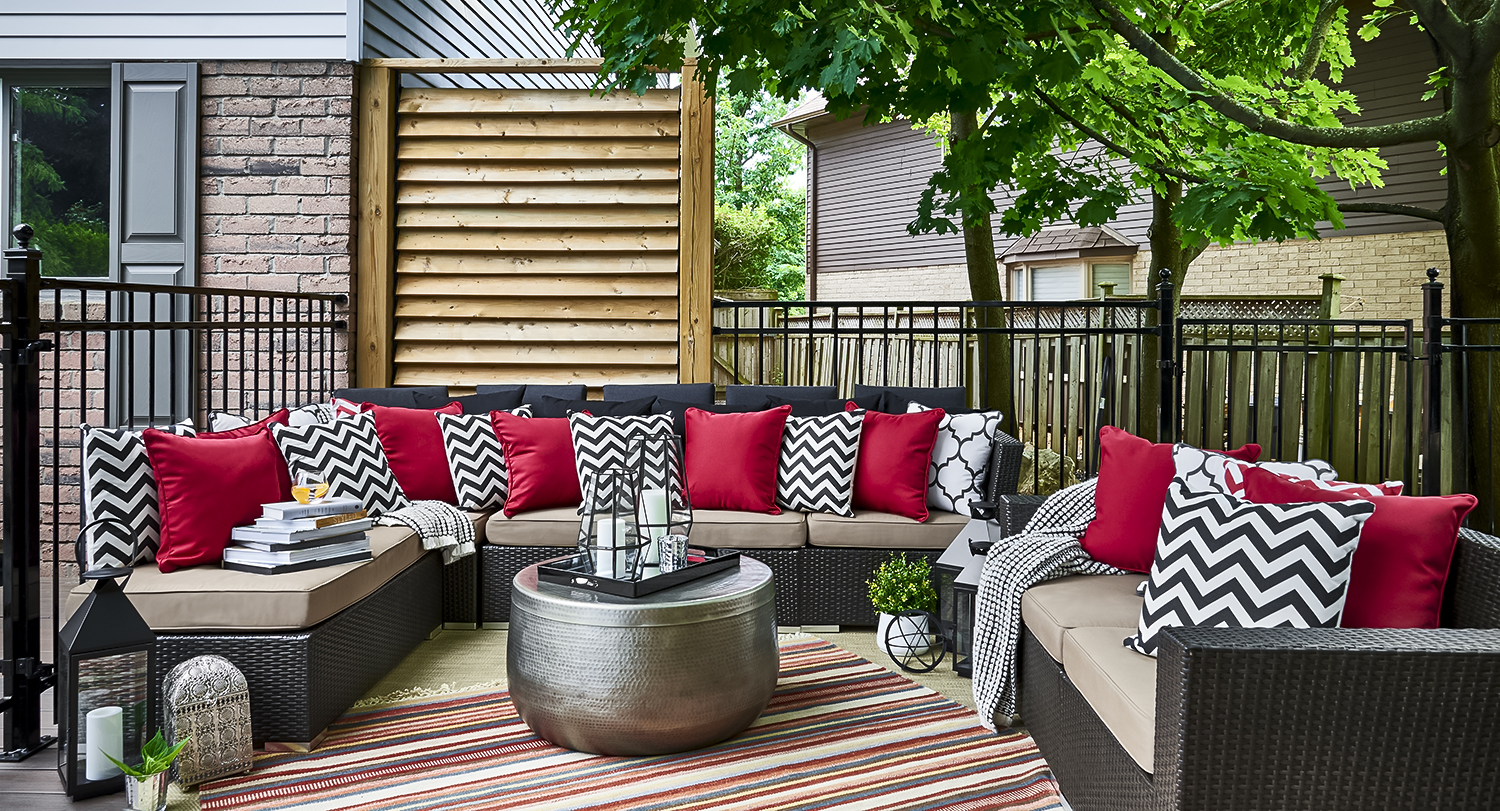 The exterior Living Room extends the living space of our Project Charter Oaks Clients and include a spacious outdoor sectional sofa and all the cozy accessories of the Home's interior