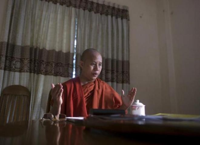 Myanmar's firebrand Buddhist monk Wirathu talks in a supporter's home during a Reuters interview in Yangon, Myanmar October 4, 2015. REUTERS/Soe Zeya Tun