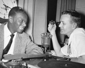 Capitol jazz artist Nat King Cole with Detroit radio personality Ed McKenzie on WXYZ radio, earlier in 1954. (Click image for larger view).