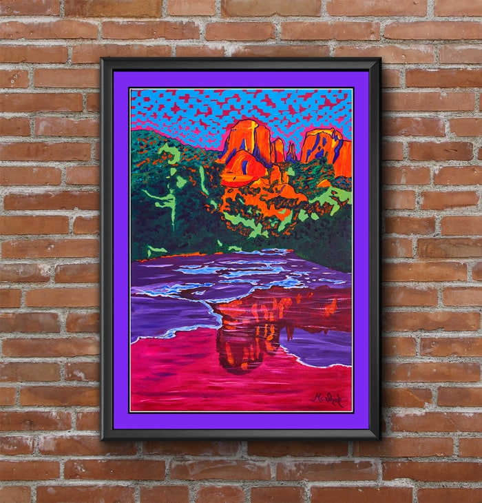 Example of what framed art looks like with a brick wall background