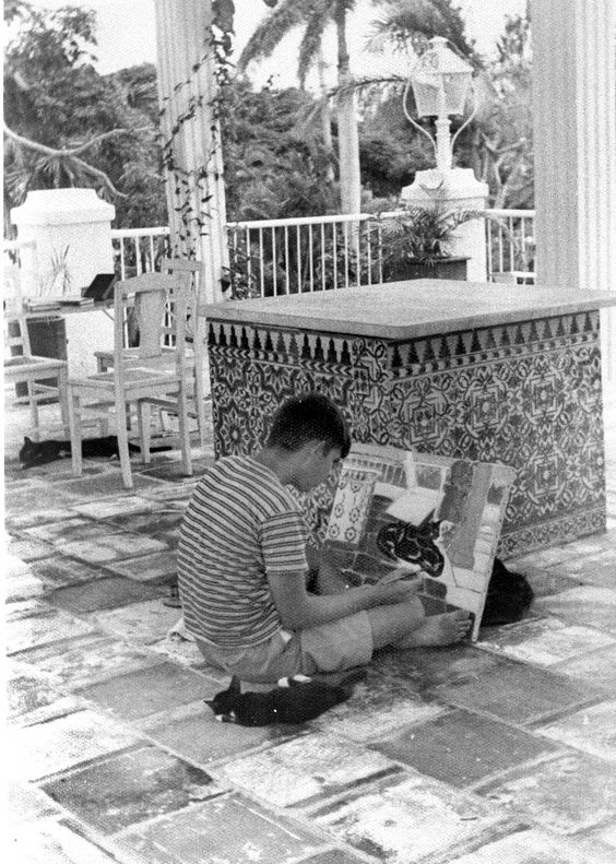 EH 8499P Patrick Hemingway paints at the Hemingway home in Cuba, not dated. Photograph in the Ernest Hemingway Photograph Collection, John F. Kennedy Presidential Library and Museum, Boston.
