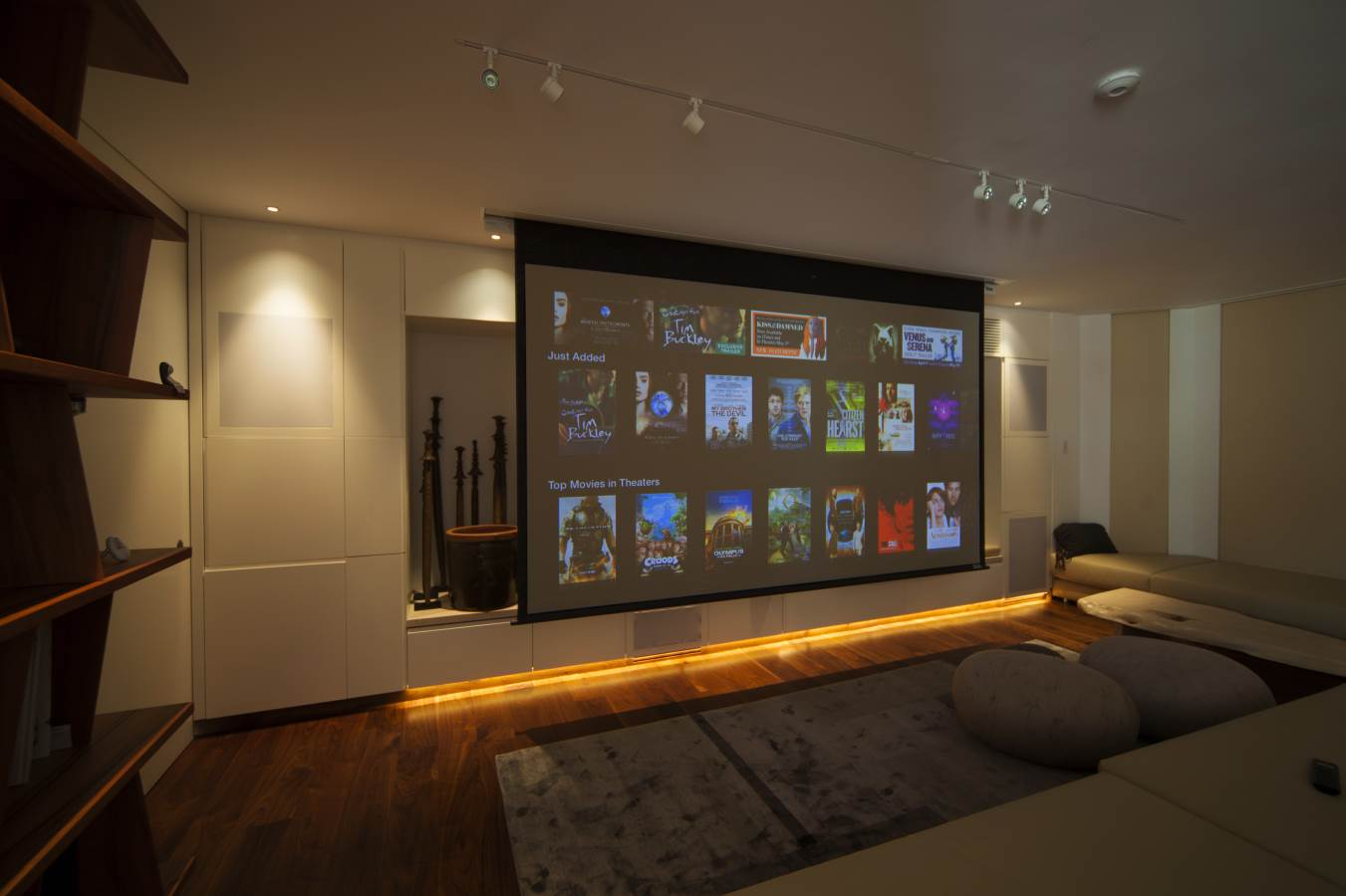 Home cinema with rollout projector screen