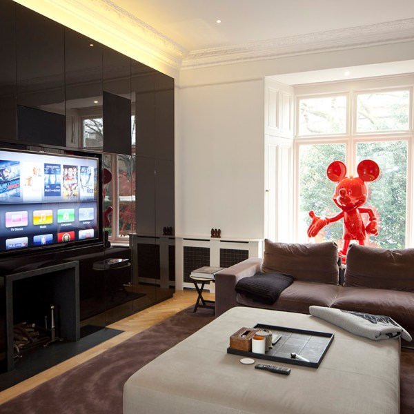Smart living room area with large Mickey Mouse artwork