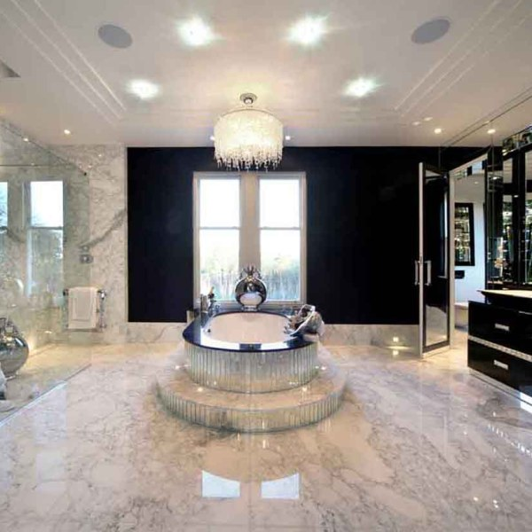 Large bathroom with marbled floor and central bath