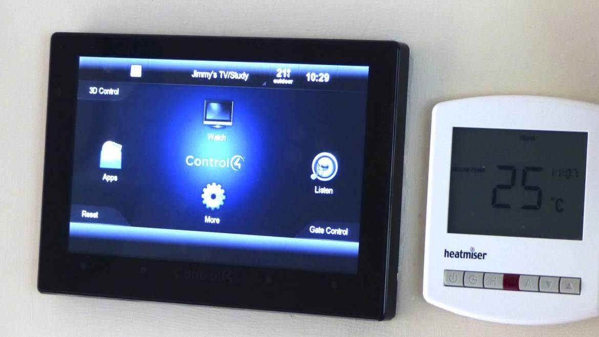 Control4 panel next to heatmiser smart heating unit