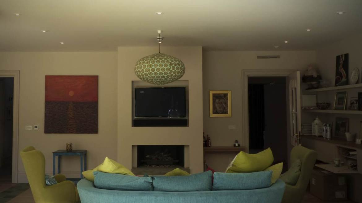 Living space in Highgate with sofa, TV and artwork