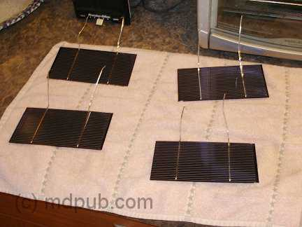 Cleaned solar cells drying on a towel