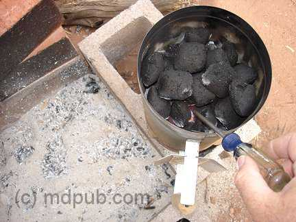 Heating up a screwdriver over a charcoal fire