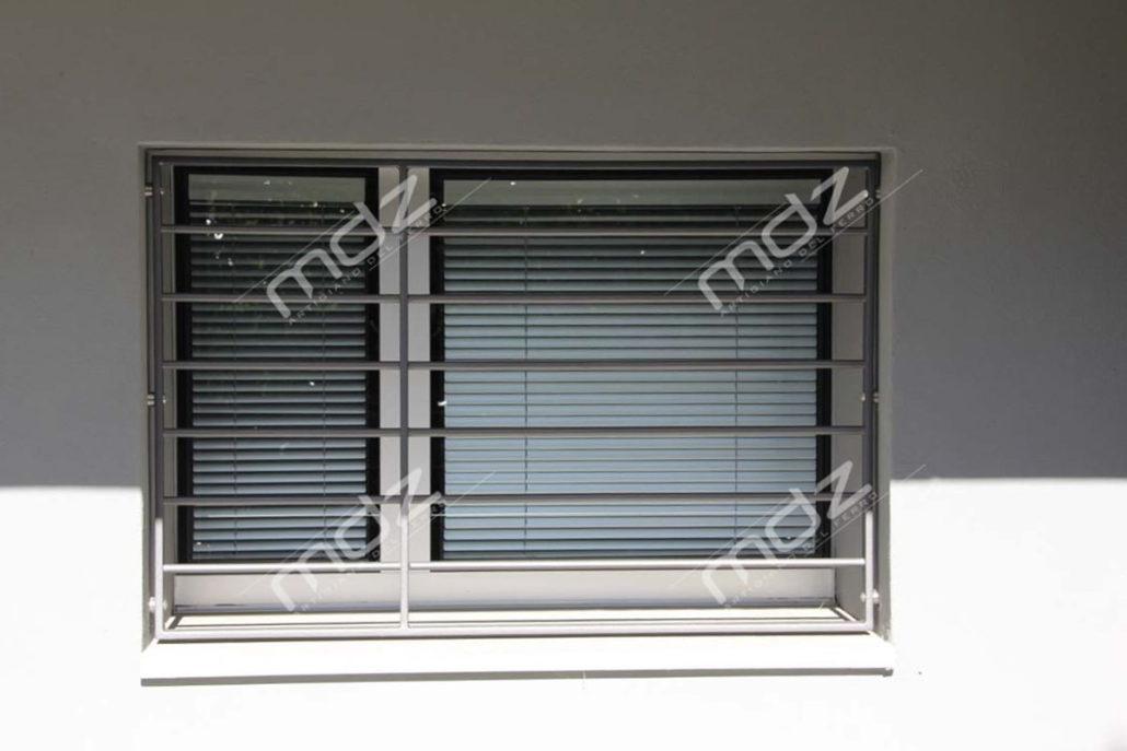 Grate per porte e finestre in acciaio inox e ferro battuto