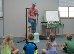 """Thad Beach entertains the kids with his """"Shake, Rattle and Roll"""" musical program."""