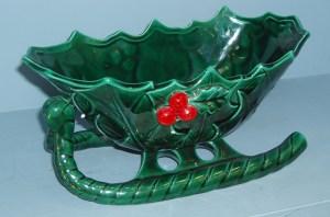 112. Antique Green Ceramic Sleigh