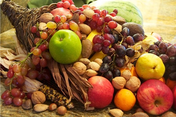 Mabon Harvest Cornucopia spilling over with fruits, veggies, and nuts