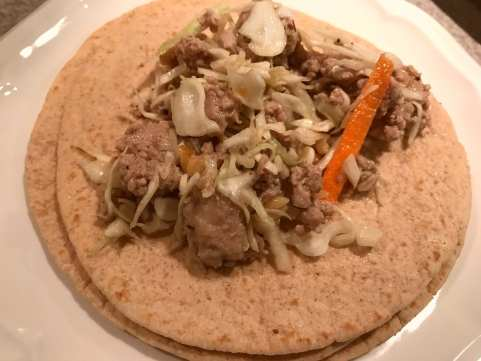 Put meat and coleslaw mixture on the tortillas