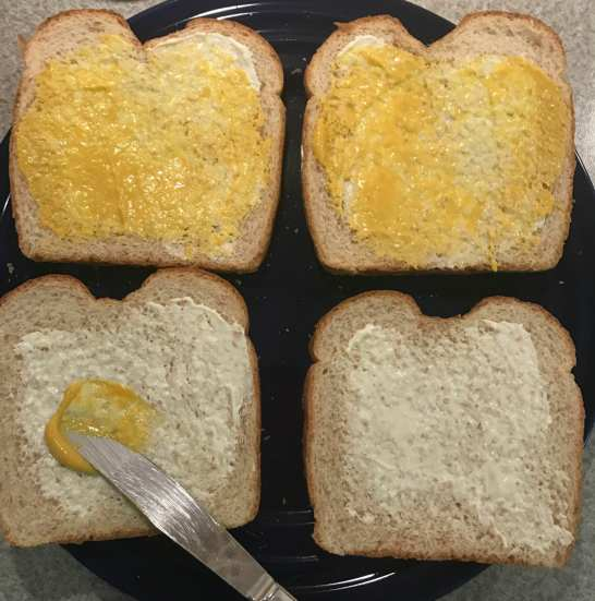 spread mayo and mustard on bread
