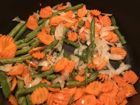 Cook carrots, green beans, and onions