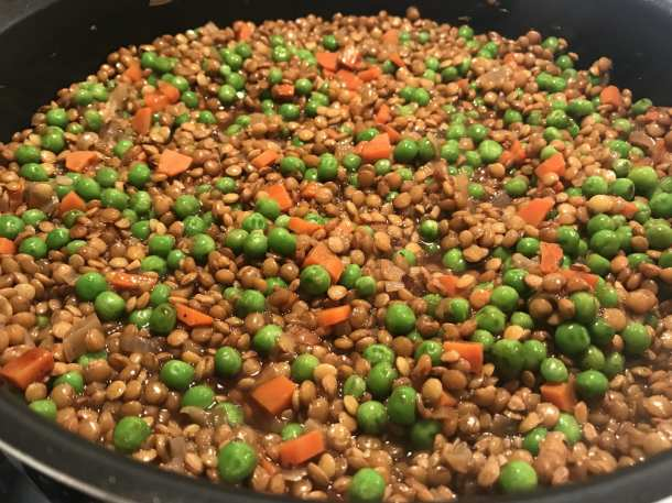ingredients for a good lentil pie include carrots, peas, lentils, soy sauce, and bbq sauce