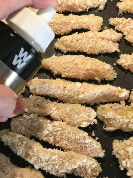 Spray chicken fries with cooking spray and baked until slightly browned.
