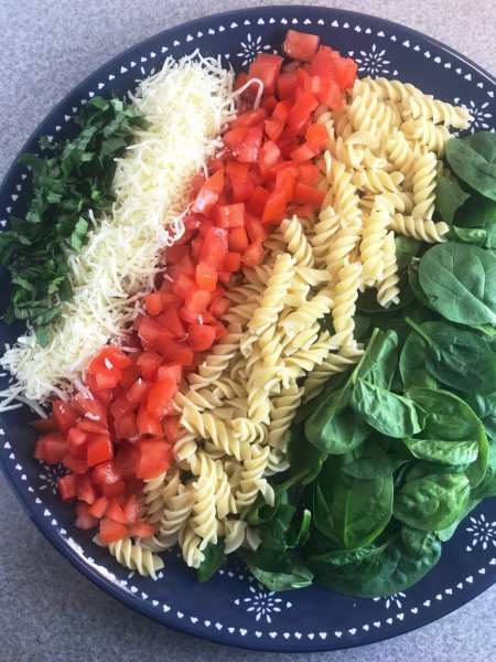 Delicious ingredients in a fresh and healthy Bruschetta Pasta Salad.