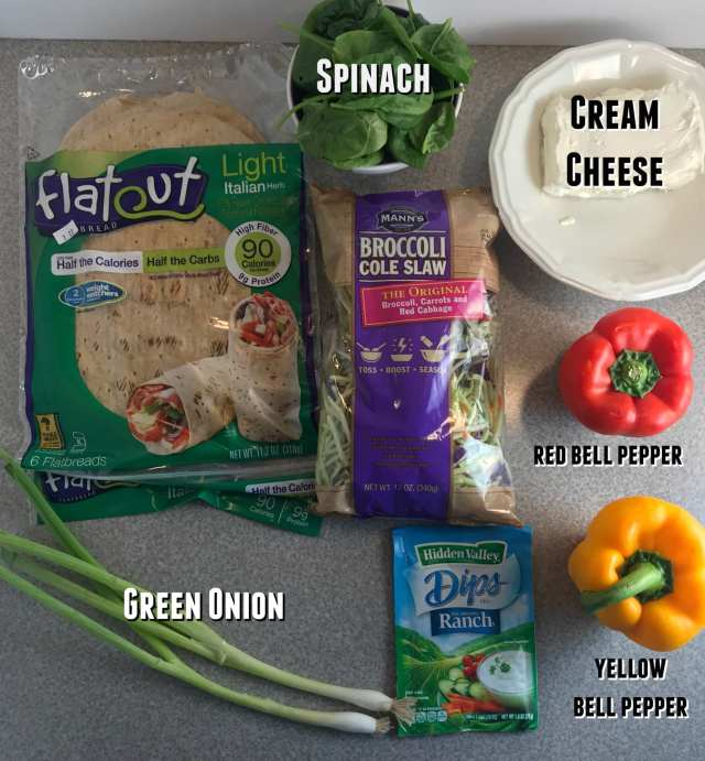 Ingredients in Alisha's Rainbow Ranch Pinwheels: Cream cheese, Ranch seasoning, broccoli cole slaw, spinach, bell peppers, green onion rolled in FlatOut wraps.