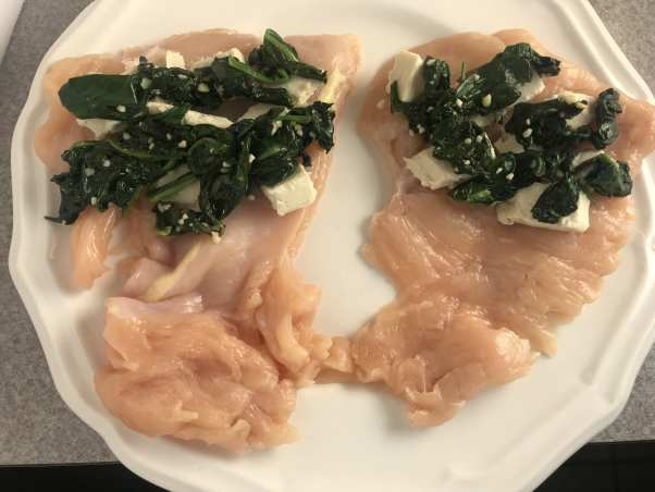 Fold over Laughing Cow cheese and spinach in a chicken breast.