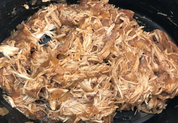 Add shredded chicken back in with the sauce.