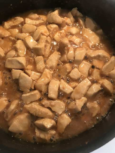 Chicken cooking in a sweet and soy sauce made of simple ingredients you probably already have.