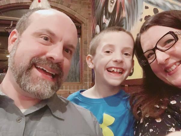 Alisha Hughes with her husband Scott and son, Kipton Hughes.