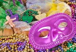 Mardi Gras beads, coins and doll