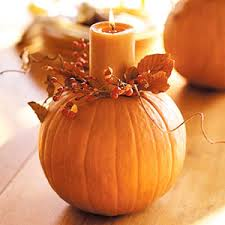 Cut the top off a pumpkin...remove seeds...and place Autumn leaves and a orange candle