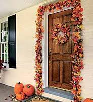 Decorate your front door with a Fall wreath...and add a stringer of Autumn leaves up and down the sides.  Add a couple pumpkins (I would use 3)