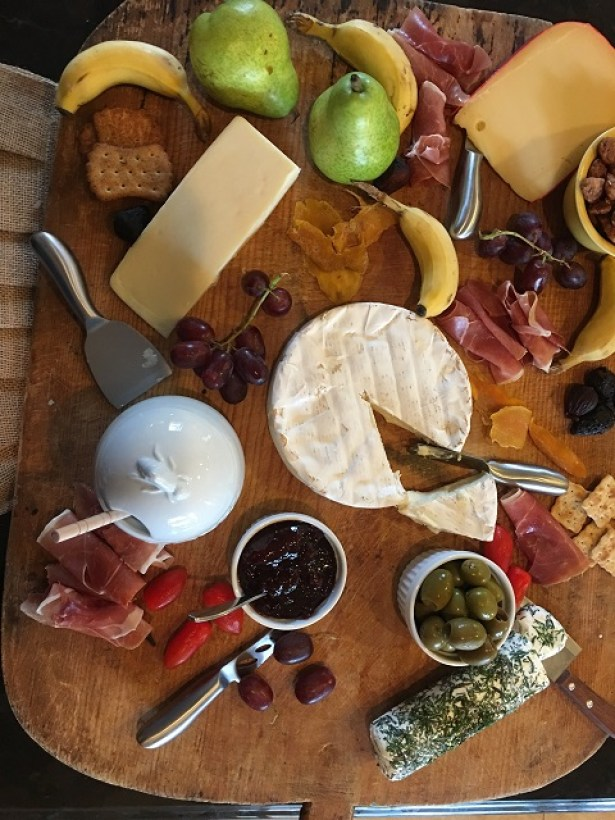 cheeseboard full of yummy appetizers
