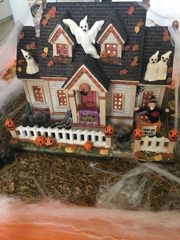 A dark and stormy night halloween story haunted house centerpiece.