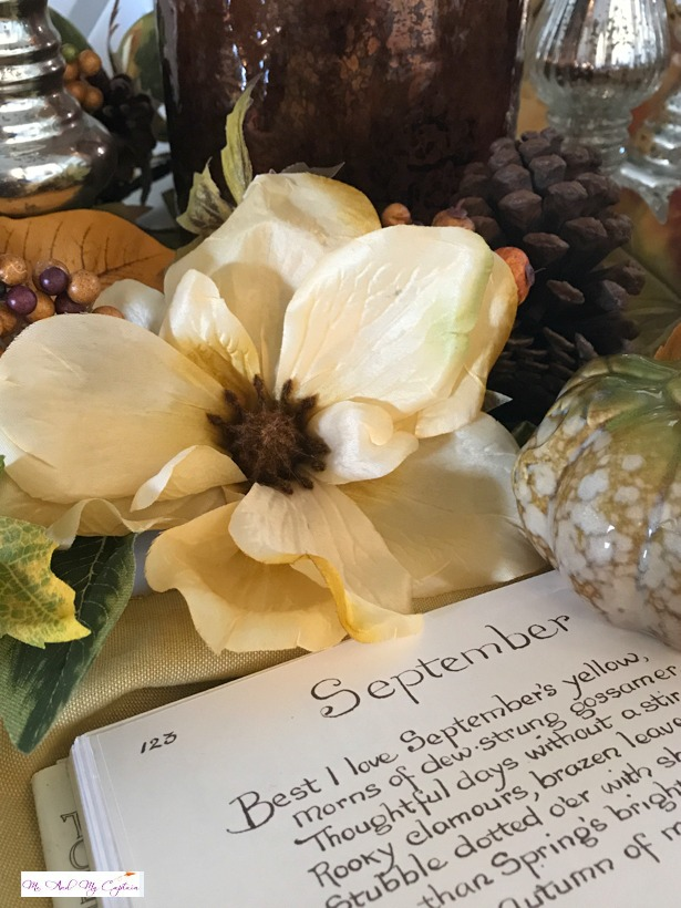 Magnolia resting on book of the month of September.