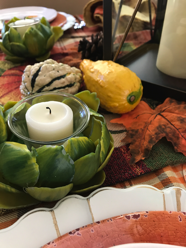 Autumn dining with artichoke votive candles.