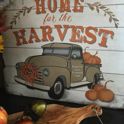 Home for the Harvest sign with a truck and pumpkins