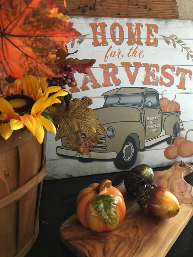 home for the harvest vignette with pumpkins and fall leaves.
