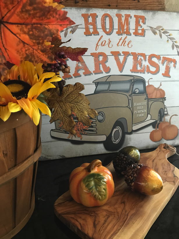 home for the harvest pick-up truck with pumpkins in the bed.