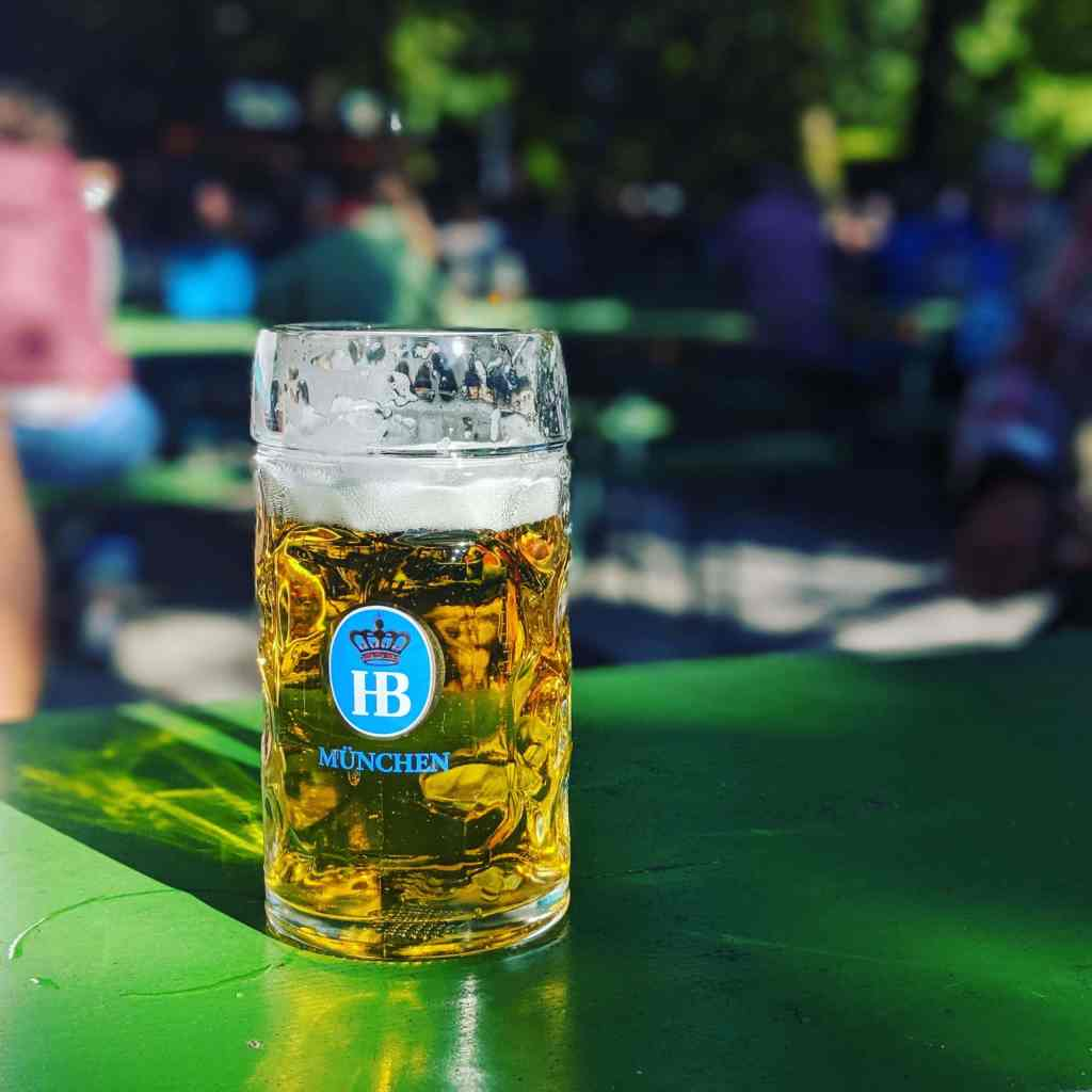 beer stein on green table in garden in germany
