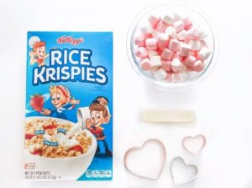 box of Rice Krispies pink and white marshmallows stick of butter heart-shaped cookie cutters