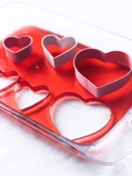 red heart-shaped jell-o jigglers and heart-shaped cookie cutters
