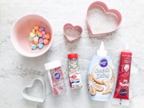 candy hearts, icing, heart-shaped cookie cutter for decorating super easy valentine desserts for kids