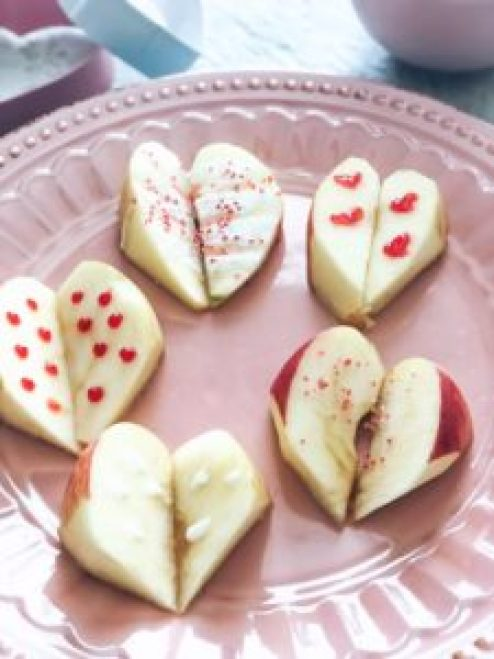 heart shaped apple slices: A healthy valentine's Day treat for the kids